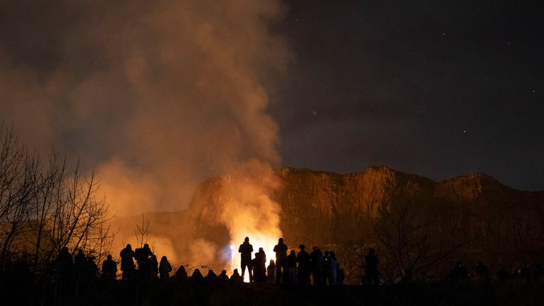 People watch on after a sizeable fire broke out on Arthur's Seat, Edinburgh