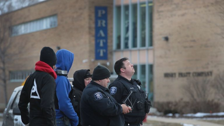 Police secure the area following a shooting at the Henry Pratt Company