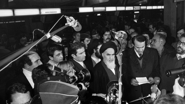 Ayatollah Khomeini speaks to journalists before boarding a flight to Tehran on 31 January, 1979