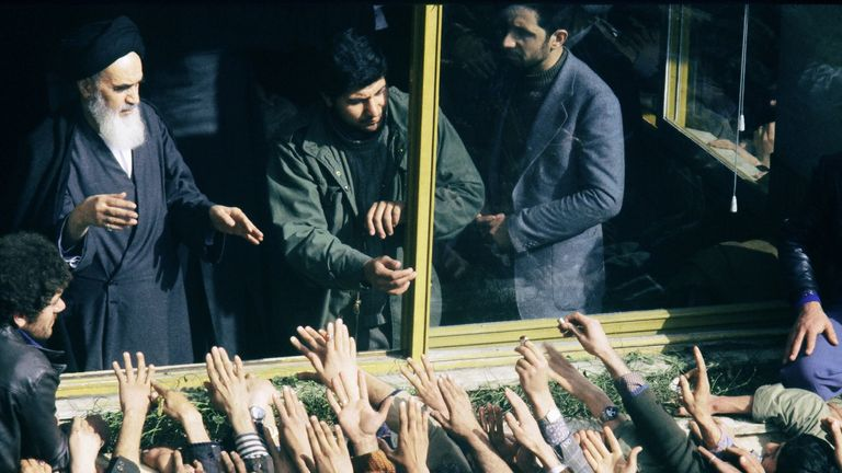 The Ayatollah Khomeini receives the adulation of his supporters after his arrival in Tehran