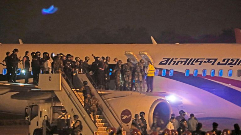 Security personnel surrounded the plane on the tarmac at Chittagong