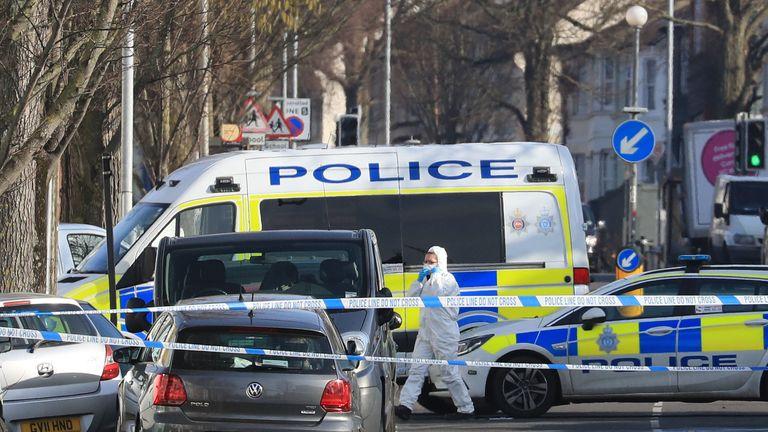 A forensics officer at the scene near St Joseph's Church in Brighton