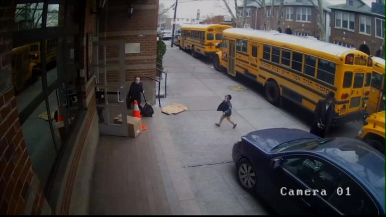 Children inches away from car on sidewalk