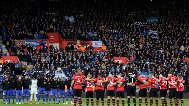 Players, officials and fans take part in a minute of silence for Emiliano Sala