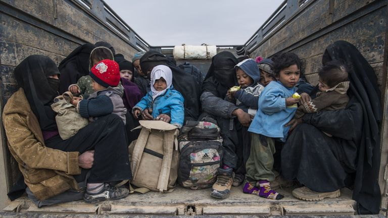Women and children who fled Islamic State in Baghouz
