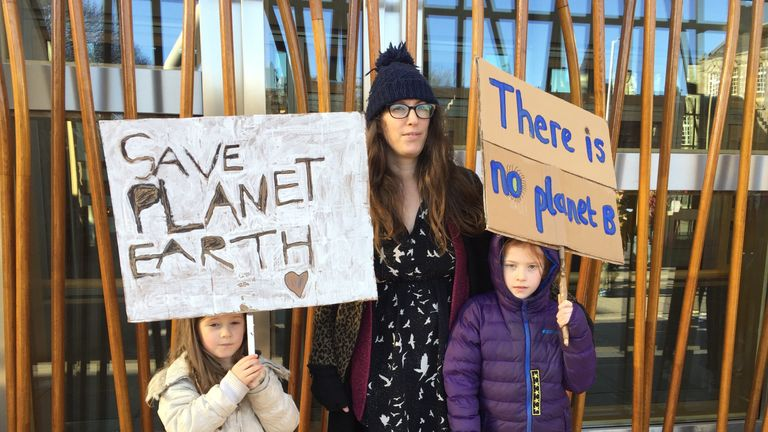 Marla Gavin-Daunt, 6, (left) and Elsie Gavin-Daunt, 8, with mum Sophie (centre) at a climate change protest outside the Scottish Parliament in Edinburgh