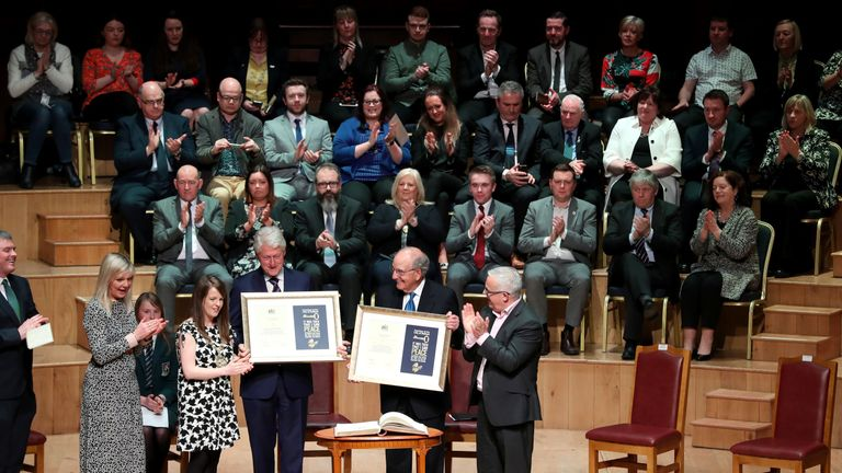 Bill Clinton and George Mitchell received the freedom of the city of Belfast