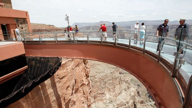 Tourists walk over the Grand Canyon Skywalk, built 4,000 feet above the Colorado River