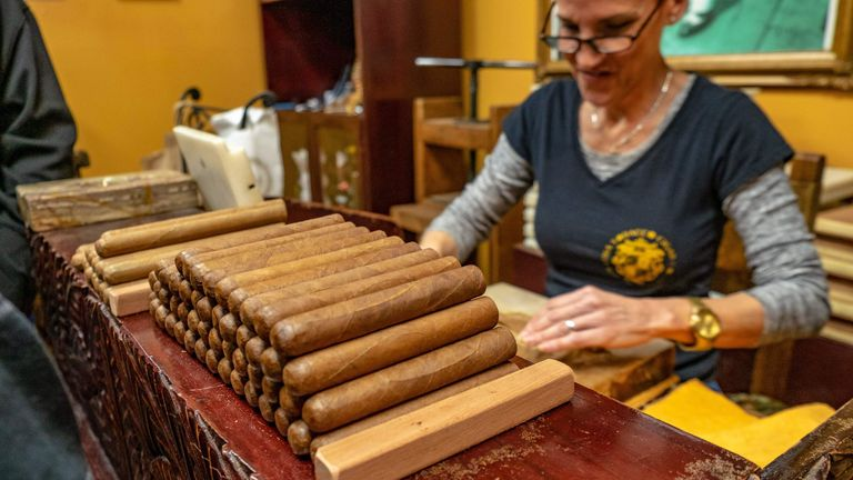 Talía Sintado rolls cigars at the Cuba Tobacco Co. on Calle Ocho in Miami's Little Havana