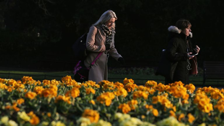 People walk through St Stephen's Green in Dublin during the mild weather