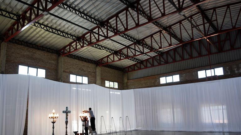 The service took place inside the gymnasium where Sala learned to play football