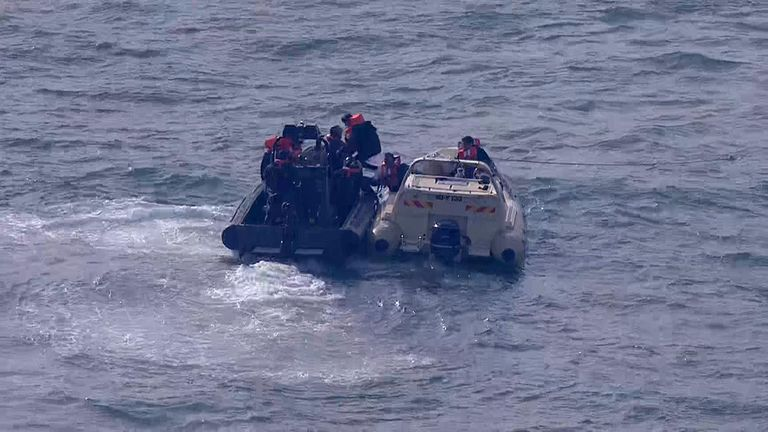 The RNLI picks up suspected migrants from a small craft in the English Channel