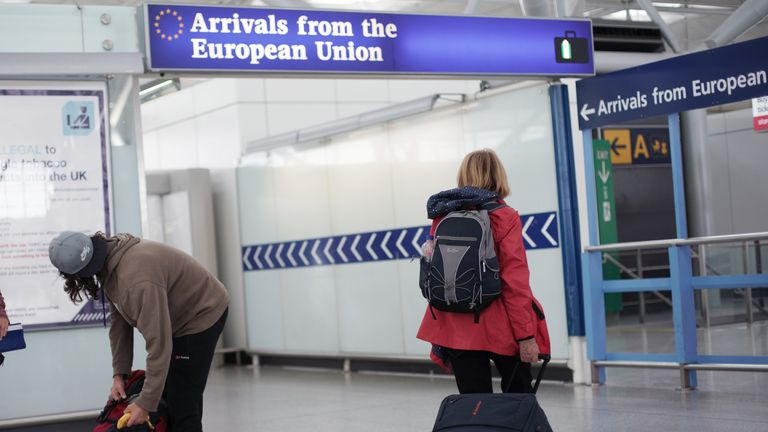 Travellers arriving from the European Union at London Stansted Airport, in Essex
