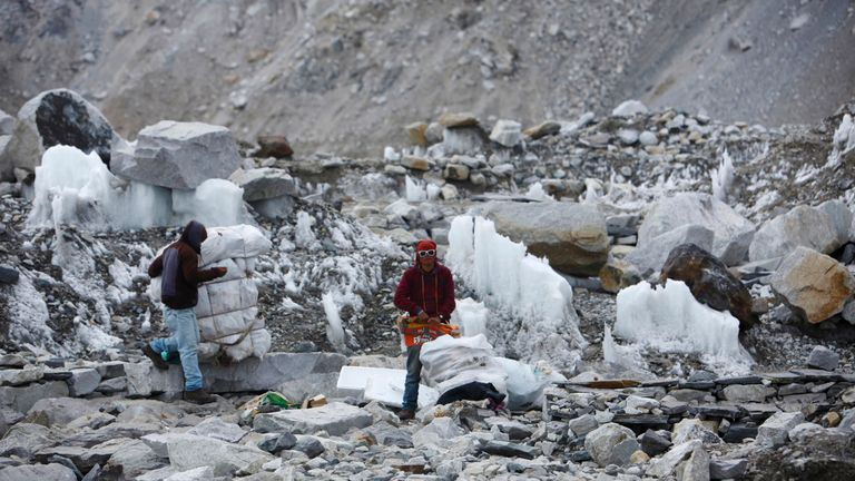 Garbage collectors collect rubbish at the deserted Everest base camp