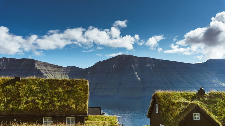 Homes with grass roofs in the village of Saksun in the Faroe Islands