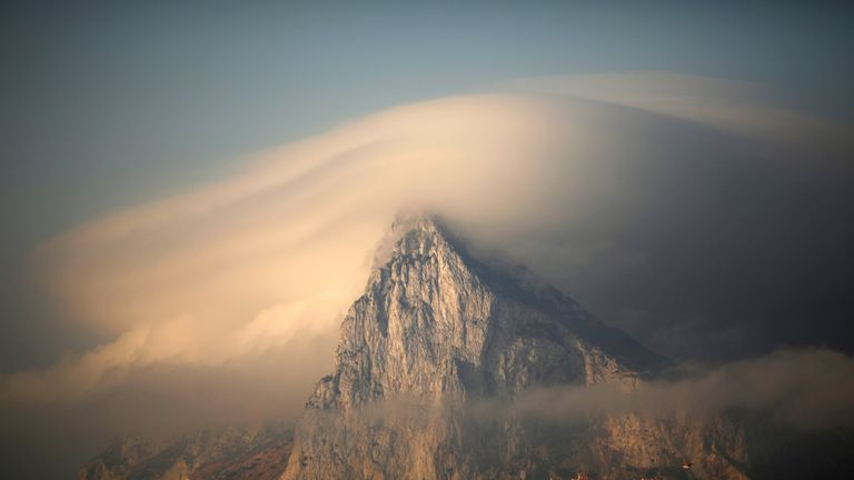 FILE PHOTO: A cloud partially covers the tip of the Rock of the British territory of Gibraltar