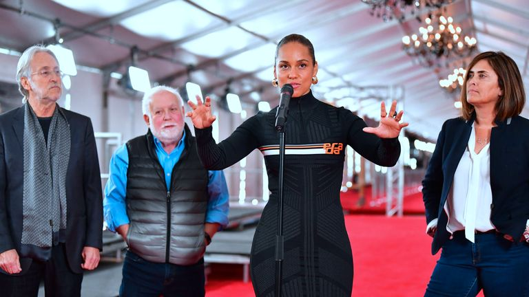 Fifteen-time Grammy winner Alicia Keys Alicia Keys is joined by Neil Portnow (L), Ken Ehrlich (2ndL) and Chantal Saucedo (R) in the unrolling of the Red Carpet on February 7, 2019 in LA for the 61st Grammy Awards