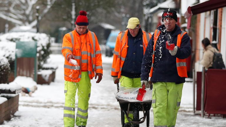 Workers have been spreading grit on snow-covered pavements in Hampshire