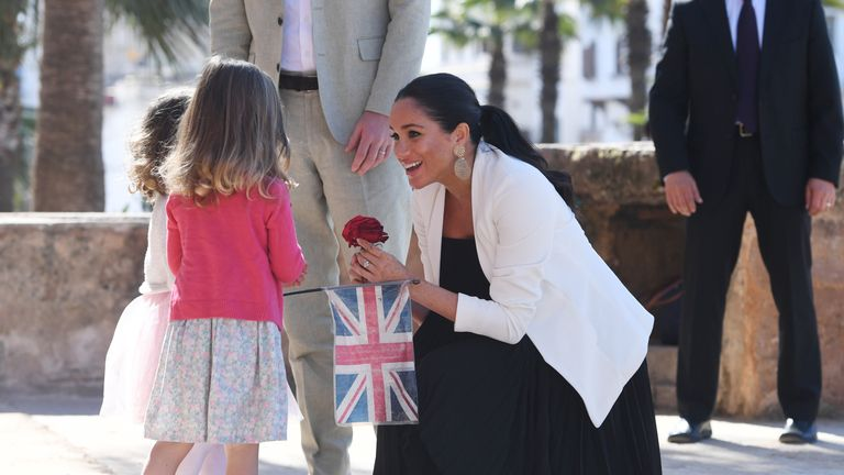 Meghan Markle gets all the flowers - and attention - in Morocco.