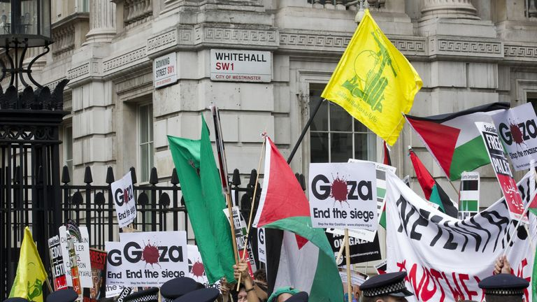 Pro-Palestinian demonstrators carrying yellow Hezbollah flags in London in 2015