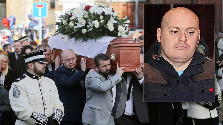 Ian Ogle's coffin is carried past the scene of his murder at Cluan Place in East Belfast. Pic: PA/Pacemaker