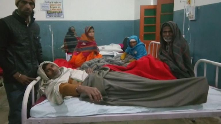 Victims of the illegal alcohol lie in a hospital in Sahranapur