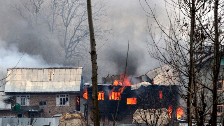Residents reported troops destroying one house with explosives during the stand-off