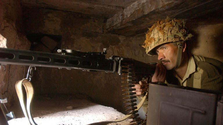 A Pakistani soldier prepares for battle at the Line of Control between India and Pakistan in 2002