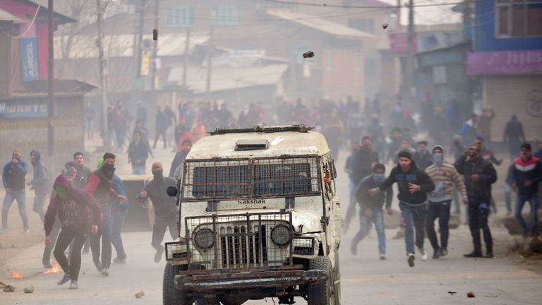 An Indian police vehicle is attacked during a protest against Indian rule in Srinagar in 2016