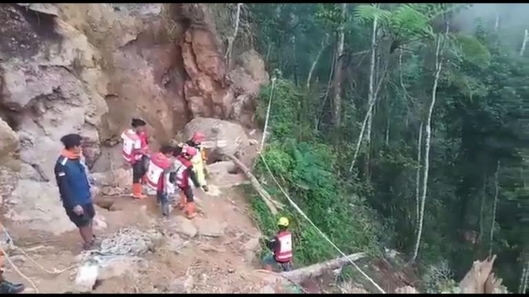 Rescue workers are using hand tools because of the fear of another landslide Pic: National Agency for Disaster Countermeasure