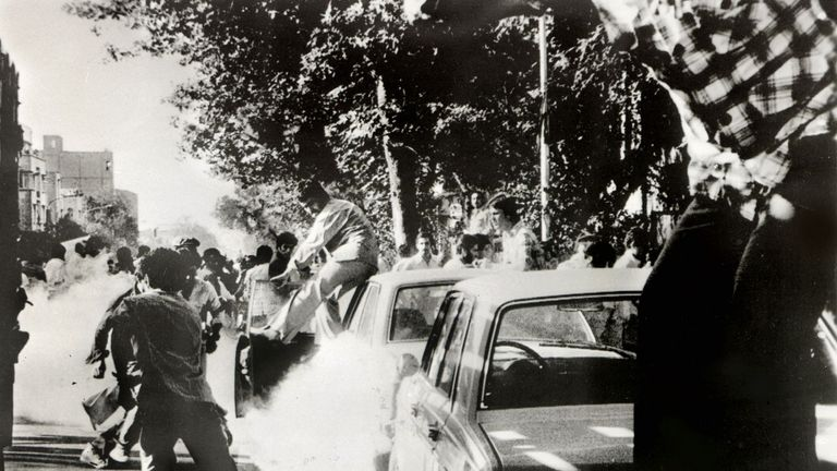 Khomeini's supporters dodge tear gas as they demonstrate in 1978, on a day when 200 died, according to activists
