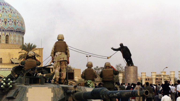 A statue of Saddam Hussein is pulled down by US soldiers after the invasion of Iraq in 2003