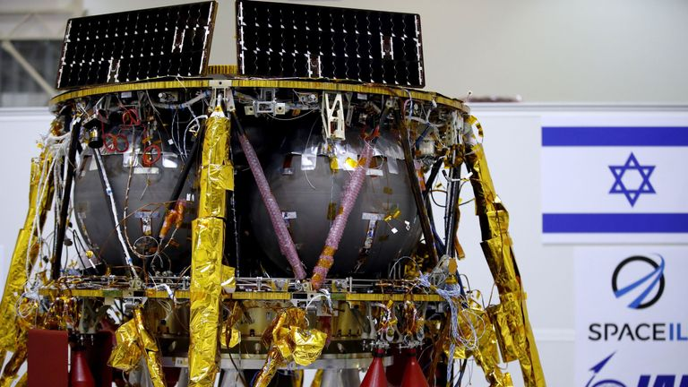 This picture shows an Israeli Aerospace Industries spacecraft during a press conference to announce its future launch to the moon, in Yehud, Eastern Tel Aviv, on July 10, 2018. - An Israeli organisation announced plans Tuesday to launch the country's first spacecraft to the moon in December in what is hoped will burnish its reputation as a small nation with otherworldly high-tech ambitions. The unmanned spacecraft, shaped like a pod and weighing some 585 kilogrammes at launch, will land on the m