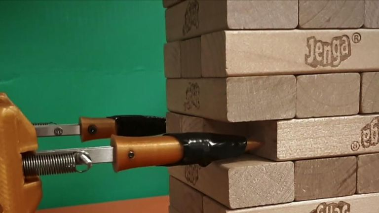 A robot learning to move Jenga blocks.