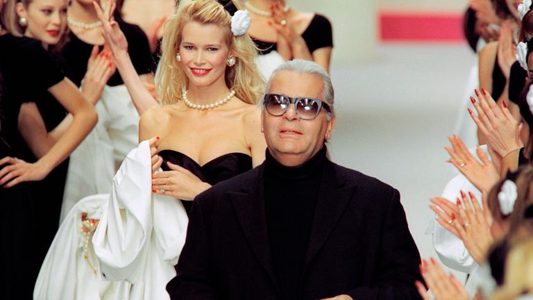 Lagerfeld with model Claudia Schiffer on the runway in 1996