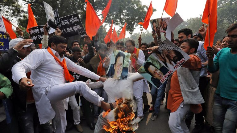Hindu activists set fire to an effigy resembling the Pakistan leader Imran Khan after the attack
