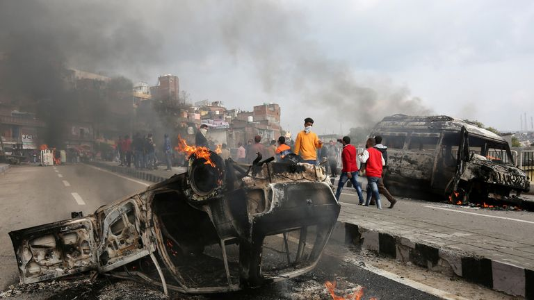 Vehicles were set alight by demonstrators after the bombing on Thursday