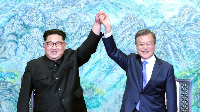 North Korean leader Kim Jong Un (L) and South Korean President Moon Jae-in (R) pose for photographs after signing the Panmunjom Declaration