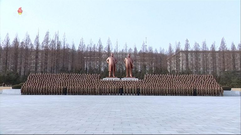 Kim Jong Un takes part in a military parade in celebration of the anniversary of the founding of his country's military