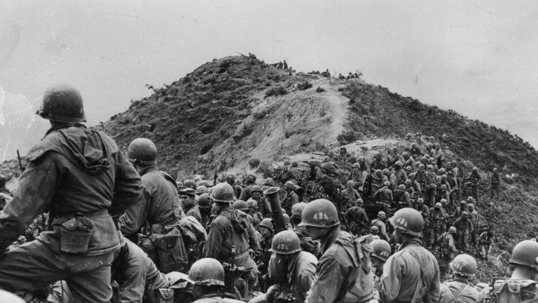 US soldiers take a position on a ridge during the war in Korea in 1951
