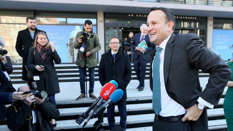 Ireland's Prime Minister Leo Varadkar (R) speaks to members of the media as he arrives at Dublin Castle