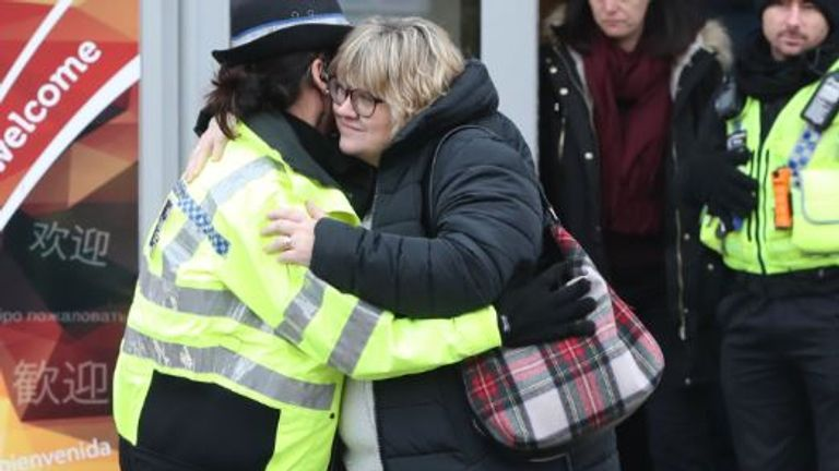 Libby's mother Lisa hugs a police officer after the service
