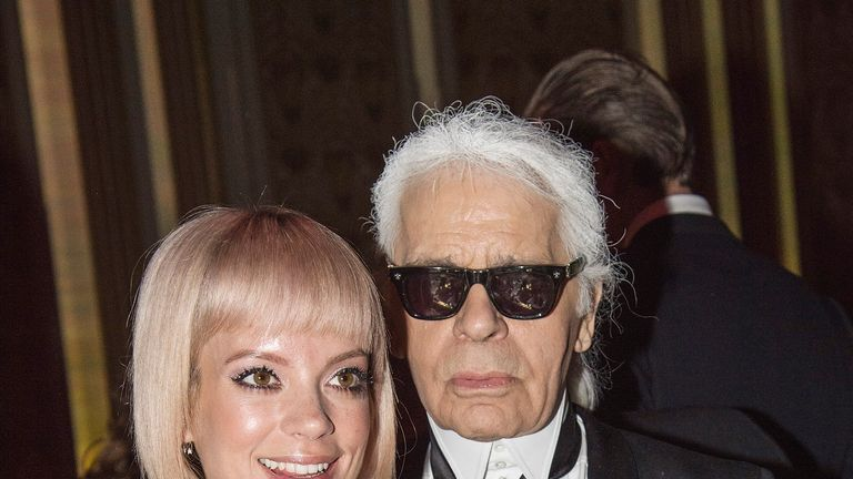 Singer Lily Allen poses with Lagerfeld at an event in 2015