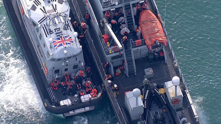 The migrants, in orange life jackets, were transferred from one Border Force boat to another