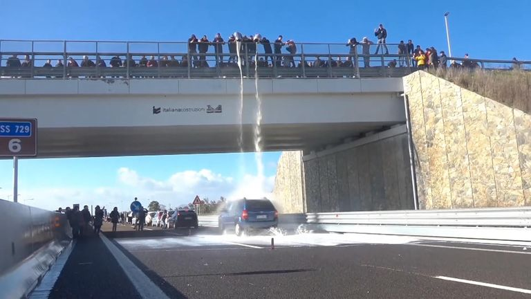 Sardinian farmers and shepherds protested against low milk prices, dumping thousands of litres of milk from an overpass.