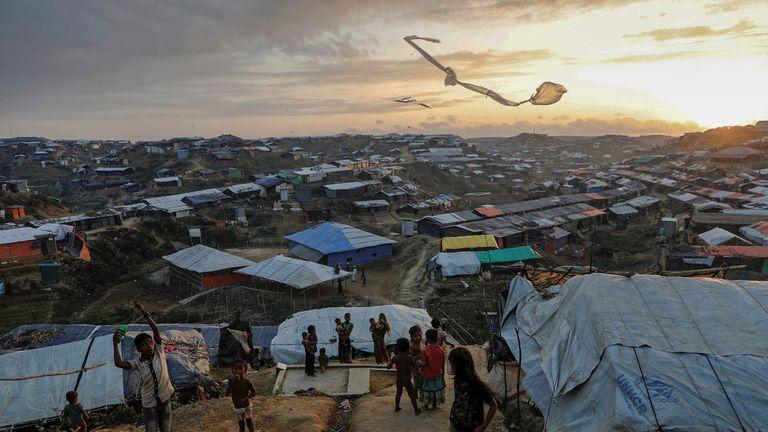 Rohingya refugee children fly improvised kites at the Kutupalong refugee camp near Cox's Bazar, Bangladesh