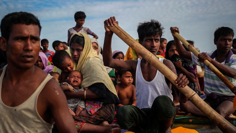 Rohingya refugees cross the Naf River with an improvised raft to reach to Bangladesh in Teknaf, Bangladesh