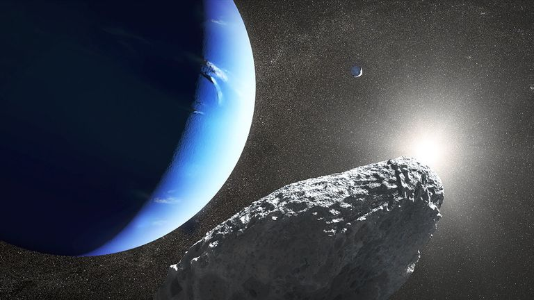 This is an artist's concept of the tiny moon Hippocamp that was discovered by the Hubble Space Telescope in 2013. Only 20 miles across, it may actually be a broken-off fragment from a much larger neighboring moon, Proteus, seen as a smaller crescent in the upper right. This is the first evidence for a moon being an offshoot from a comet collision with a much larger parent body. Credit: NASA, ESA and J. Olmsted (STScI)
