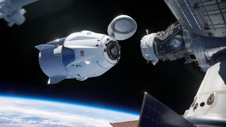 Artist's impression of the SpaceX capsule docking with the ISS
