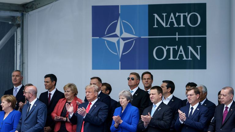 NATO leaders, (front row, LtoR) German Chancellor Angela Merkel, Belgium's Prime Minister Charles Michel, US President Donald Trump, Britain's Prime Minister Theresa May, Estonia's Prime Minister Juri Ratas, Slovenia's Prime Minister Miro Cerar and Turkey's President Recep Tayyip Erdogan and (2nd row, LtoR) Montenegro's Prime Minister Duko Markovi?, Spain's Prime Minister Pedro Sanchez, Norway's Prime Minister Erna Solberg, Romania's President Klaus Werner Iohannis, Netherland's Prime Minister M